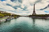 Eiffel Tower seen from Seine River in Paris, France. Capital cities of Europ. Travel destinations. poster