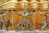 Giant Statue Support Gold Chedi In Wat Phra Keaw