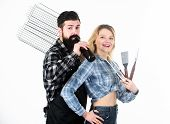 Drinking While Cooking. Happy Couple Using Cooking Grid For Barbecue Party. Pretty Woman And Bearded poster