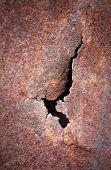 Crack At Rusty Metal Plate