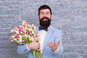 Macho Getting Ready Romantic Date. Tulips For Sweetheart. Romantic Gift. Man Well Groomed Tuxedo Bow poster