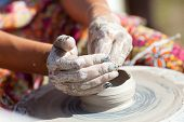 Hand On A Potter Wheel At The Fair