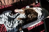 Tired Woman Lying In The Bed From The Top View. Not A Morning Person Concept. Teen Girl With Her Fac poster
