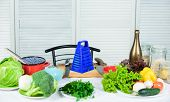 Table With Culinary Utensils And Vegetables Ingredients. Fresh Vegetables Ingredients For Healthy Me poster