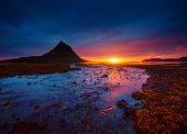 Great sunset over the Atlantic ocean. Location place Kirkjufell volcano the coast of Snaefellsnes pe poster