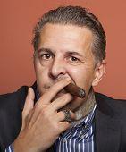 picture of hustler  - Man wearing suit gangster style smoking cigar - JPG