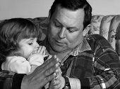 image of father daughter  - father teaching his little girl to pray in black and white - JPG