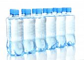 plastic bottles of water isolated on white