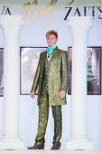 MOSCOW - NOVEMBER 4: Man in bright suit on show of designer Slava Zaitsev in fashion house of Slava
