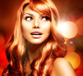 pic of blinking  - Beautiful Woman With Shiny Red Long Hair over Blinking Holiday Background - JPG