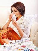 Woman with remedy having  flue in bed. Isolated.