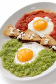 huevos divorciados, fried eggs on corn tortillas with two salsas, mexican breakfast