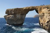 GOZO, MALTA - JUNE 6: Tourist visiting the famous stone arch, Azure Window, on June 6, 2012 in Gozo,