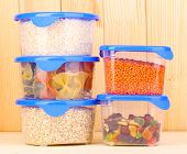 picture of tupperware  - Filled plastic containers on wooden background - JPG