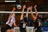KAPOSVAR, HUNGARY - OCTOBER 7: Agnes Recsei (in white) in action at the Hungarian I. League volleyba