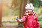 picture of tit  - Adorable little girl and great tit bird sitting on her finger - JPG