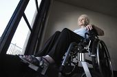 stock photo of physically handicapped  - Low angle view of a senior woman in wheelchair - JPG