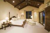 stock photo of neutral  - Neutral bedroom with high wooden ceiling - JPG