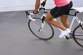 Female Cyclist Making Excercise On Race Bike. Image With Panning