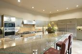 pic of stool  - Glass topped breakfast table in modern kitchen - JPG
