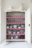 Open storage cupboard showing display of homeware