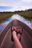 Man Relaxing In A Canoe Point Of View