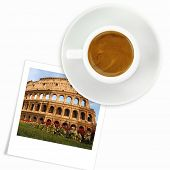 Cup of coffee and a photo of colloseum in Italy