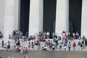 WASHINGTON, D.C. - JULY 29: Tourists stand outside the Lincoln Memorial on July 29, 2013 in Washington, D.C. The memorial was dedicated in 1922.