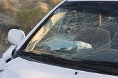 Closeup of a smashed car windshield on desert highway