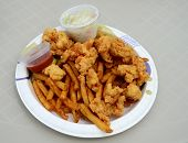 Fried Conch Fritters And French Fries