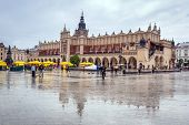 CRACOW, POLAND - JUNE 28: Rainy day on the main market square of the Old Town in Krakow on 28 June 2