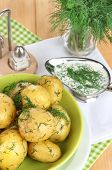 Boiled potatoes on platens on on napkins on wooden table