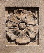 Old Sandstone Sculpted Flower With Lichen And Spiderwebs
