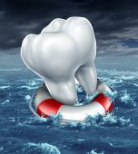 stock photo of molar  - Dental help protection as a medical dentistry concept with a white molar tooth being saved by a lifesaver or lifebelt as a metaphor for fighting against tooth decay and rescue from cavities on an ocean storm background - JPG