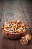 walnuts in the brown wooden bowl