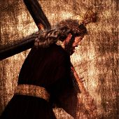 stock photo of passion christ  - Jesus Christ carrying the Holy Cross on a vintage background - JPG