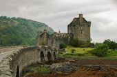 stock photo of tide  - Eilean Donan castle on a cloudy day - JPG