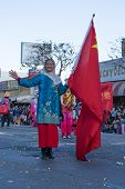 Asian Chinese Woman With Flag In The 115Th Annual Golden Dragon Parade, Lunar New Year Celebrations