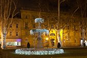 The first fountain at Zrinjevac decorated by Christmas lights. Because of its swelling, organic shape the fountain is popularly known as The Mushroom. poster