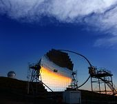 LA PALMA, CANARY ISLANDS, SPAIN - JULY 12, 2012: Magic telescope at sunset in ORM observatory at Roque de los Muchachos in La Palma, Canary, Spain, July 12, 2012. Is a gamma-ray high sensivity mirror.