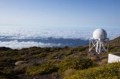 LA PALMA, CANARY ISLANDS, SPAIN - JULY 13, 2012:ORM observatory at Roque de los Muchachos by IAC institute, high angle view over a sea of clouds in La Palma, Canary, Spain, July 13, 2012.