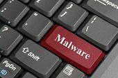 Red malware key on keyboard