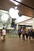 HONG KONG, CHINA - NOVEMBER 11, 2012: Buyers at the entrance at Apple store in Hong Kong. Store is in a shopping center IFC Mall, it is very popular with locals and tourists visiting Hong Kong.