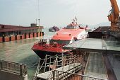MACAU, CHINA - NOVEMBER 4, 2012: Fast passenger ferry hydrofoil Turbojet at berth marine terminal  M