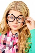 Portrait of a smart ten years girl in big glasses. Education. Isolated over white.