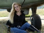 Young Woman Sitting Near Airplane
