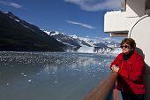 Tourist on cruise ship admires scenery