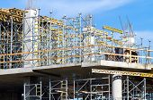 stock photo of scaffolding  - Incomplete modern building under construction with scaffolding detail - JPG