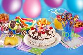 image of torte  - chocolate torte with candles and homemade sweets for children birthday party - JPG