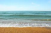 Pebble beach and sea wave